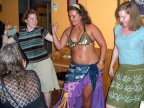 Bex and Ellyn study the belly dancer's moves