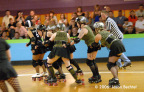 Bex Pistol makes room for her jammer to scoot through and score