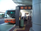 High-tech bus loading, directly outside arrivals terminal