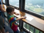 Checking out the Braille description of the view at Tokyo Tower