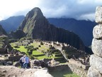 Religious area on the left, worker area on the right, and Huayna Picchu in the distance; from city gate area, Machu Picchu