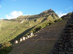 Machu Picchu itself is the mountain high above the agricultural terraces (the guardian hut sits atop the terraces)