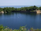 The former Babson Farm Quarry at Halibut Point State Park was close enough to the Atlantic to load ships directly from its now filled depths