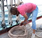 One of the crewwomen stowing a line after rasining sail