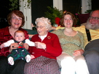 Four generations of women and one grinning patriarch