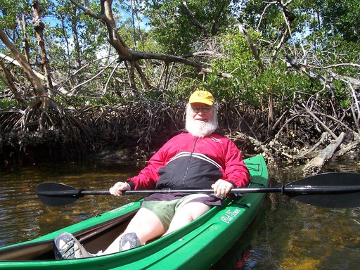 Fred relaxes in his kayak. The 30 SPF goo preserved the whiteness of his limbs.