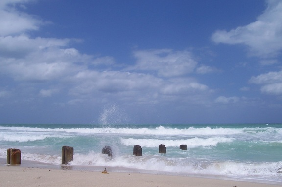 Windy beach with posts and clouds, Bal Harbour, Miami