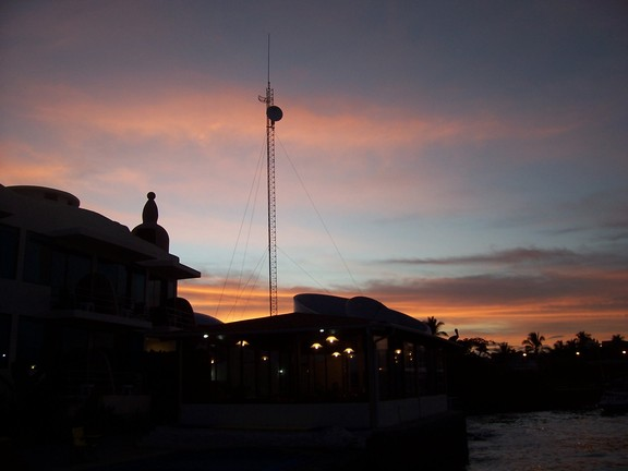 Satelite antenna for bank next door punctuates the sunset seen over our hotel, the Solymar, Puerto Ayora, Santa  Cruz, Galapagos