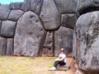S is dwarfed by the mighty--yet tight-fitted--boulders at Sacsayhuaman, outside Cusco