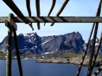 A Lofoten mountain shot from inside an unused cod drying rack