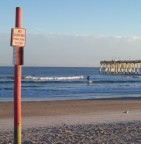 Rules are made to be broken. But don't break your neck. (Christmas, Wrightsville Beach, NC)