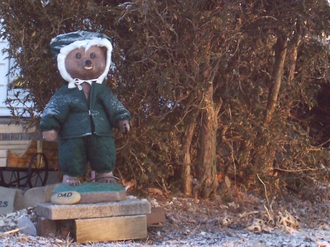 The bear across the street has two-dozen different seasonal outfits