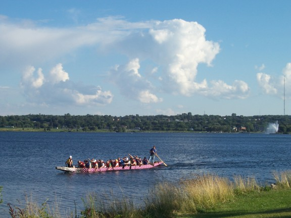 Dragon boat full of tourists, from Heritage Park, Barrie, Ontario