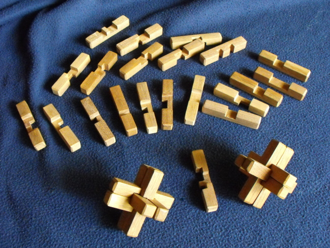 Pieces in the puzzle set I made; most choices of six pieces assemble into a six piece burr