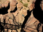 For tourists, a rickety bridge spans this ravine, Petra
