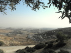Looking east from Mount Scopus, a Palestinian town with a Jewish settlement beyond