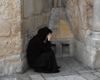 Nun praying at the entrance to the Church of the Holy Sepulchre