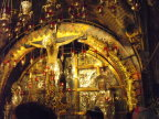 Some of the less ornate decorations in the Church of the Holy Sepulchre; lamps are everywhere