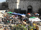 Crowds heading home for the holy days are greeted by vendors as they emerge from the Old City, Jerusalem
