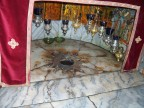 The hole looks down to the alledged site of the manger, Church of the Nativity, Bethlehem