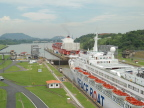Cruise ship in Miraflores Lock on Panama Canal; container ship has just exited