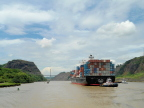 Huge container ship enters cut in Continental Divide on Panama Canal
