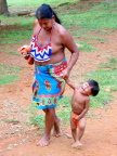 Indigenous mother and child at Embera Village on the Chagas River in Panama