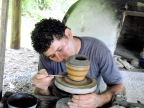 Potter Johnny at work using hand-turned wheel, Costa Rica