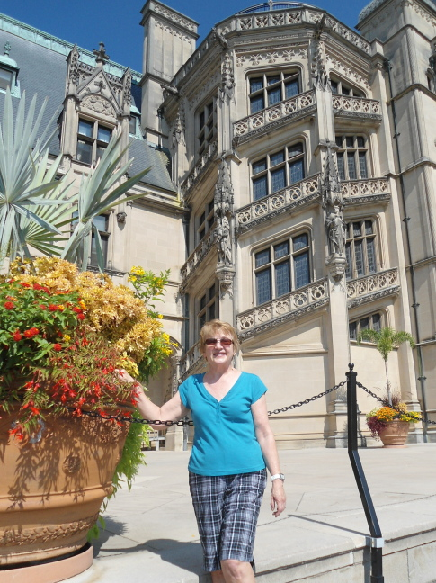 Susan poses outside the grandstaircase at Biltmore
