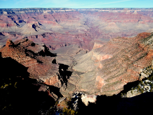 Grand Canyon's Bright Angel trail starts at the camera, winds around Maricopa Point on the left, and offers a side excursion to the plateau in the middle