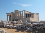 Erechtheion with the porch of the Caryatids.  The Sacred Olive Tree left of center  is supposedly descended from an original tree planted by Athena.