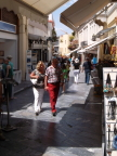 Modern shopping street in Plaka, in the shadow of the Acropolis, Athens