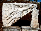 Nike, goddess of victory, is holding laurel leaves to bestow upon a winner in Ephesus