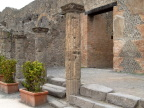 Steps, colums, and a decorated wall in Pompei