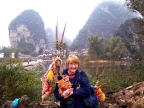 Enjoying the monkeys near the Banyan tree outside Guilin, China