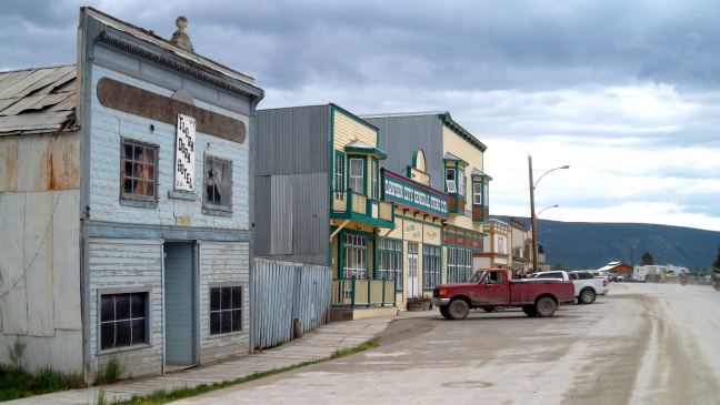 Dawson City storefronts, dirt roads, pickups