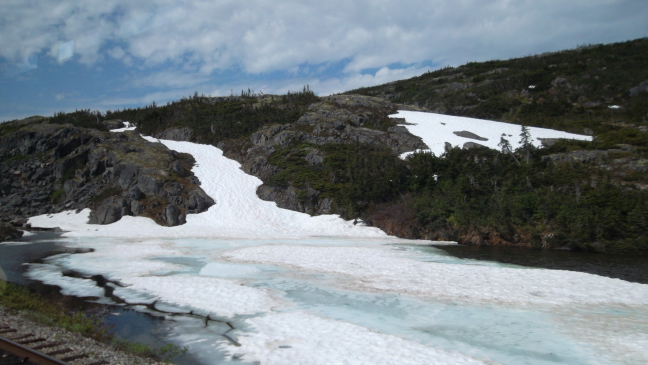 June, 85 degrees, and still ice and snow on White Horse Pass