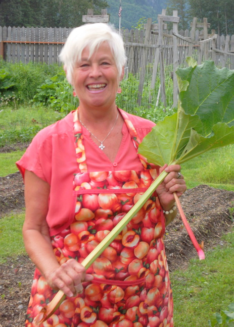 Garden tour guide and chef at Jewell Gardens shows off rhubarb, Skagway. Miners ate it to prevent scurvy.