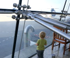 Tot ignores fabulous glass fittings at Seatac airport, WA