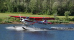 Seaplane showing off for the Riverboat Discovery tour on the Chena River near Fairbanks