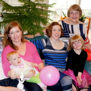 One grandma, three mothers, four daughters, two grandkids, and a pink balloon