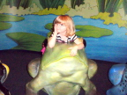 Lindsay rests with frog on lily pad at Cincinatti Children's  Museum