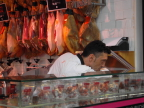 Meat vendor of Iberian ham, in Mercado, Old City