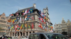 Flags bedeck the medieval town Hall in Antwerp
