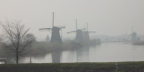 Windmills in the mist at Kinderdijk