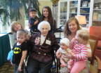 Edith surrounded by her great-grandkids
