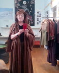 Trying on medieval clothing at Reykjavik National Museum