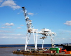 Crane waits to move containers between ship and shore, Buenos Aires