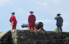 Firing the noonday cannon, Fort Louisburg