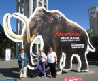 Visitors get shot in front of the mammoth ad, Victoria BC